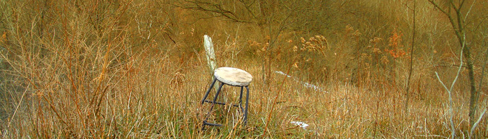 Metal-stool-on-hillside